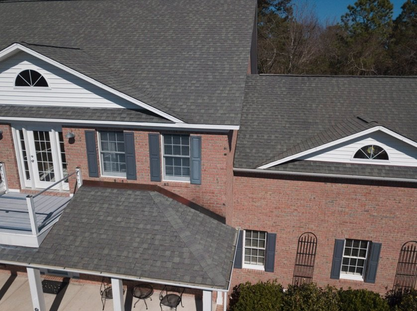Architectural Shingles on a house with brick