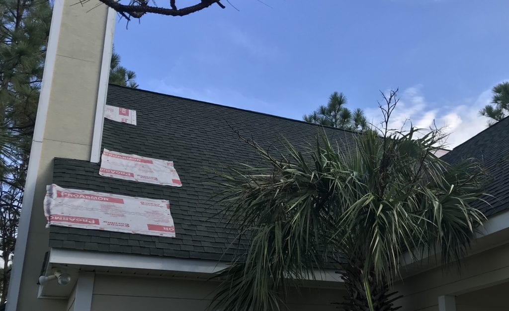 wind damaged shingles with repair