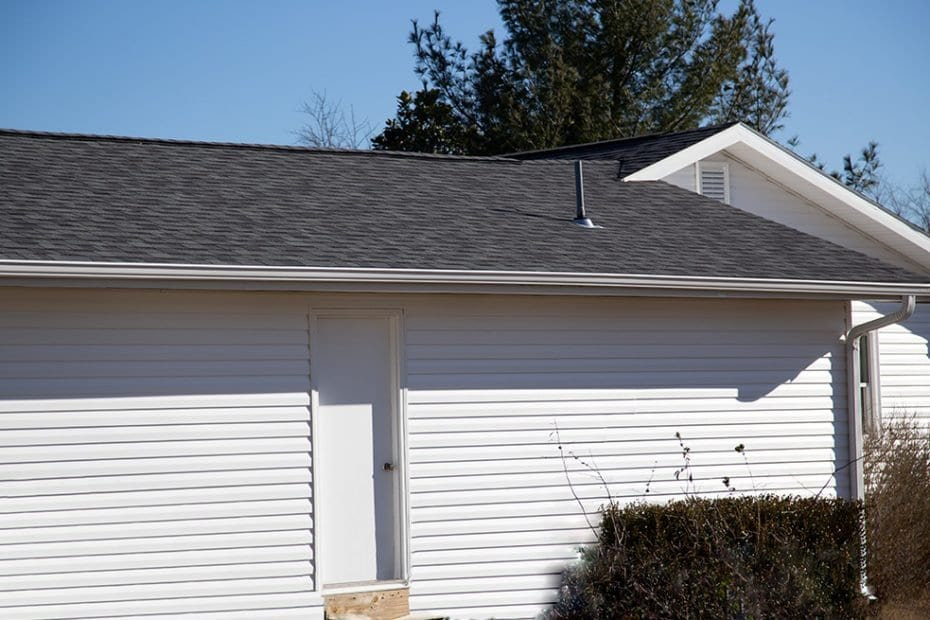 house with new roof, siding, and gutters