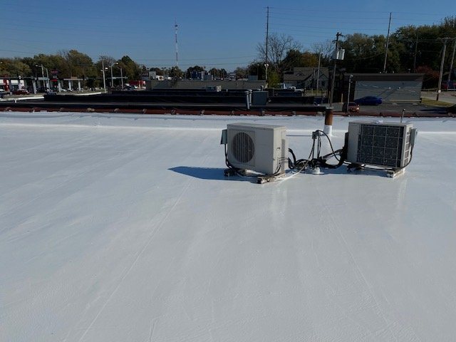Elastomeric coating on a flat roof in Springfield, MO