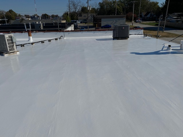 silicone coating to renew and seal a flat roof in springfield mo