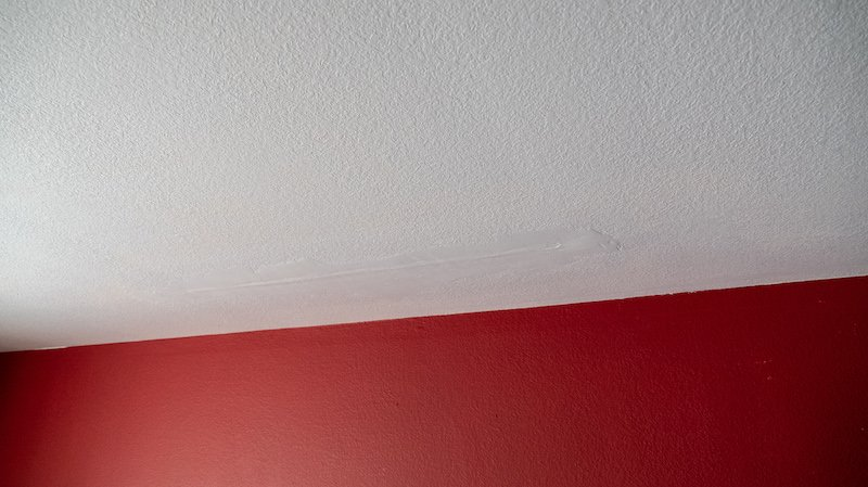 bad drywall repair from water damage roof leak