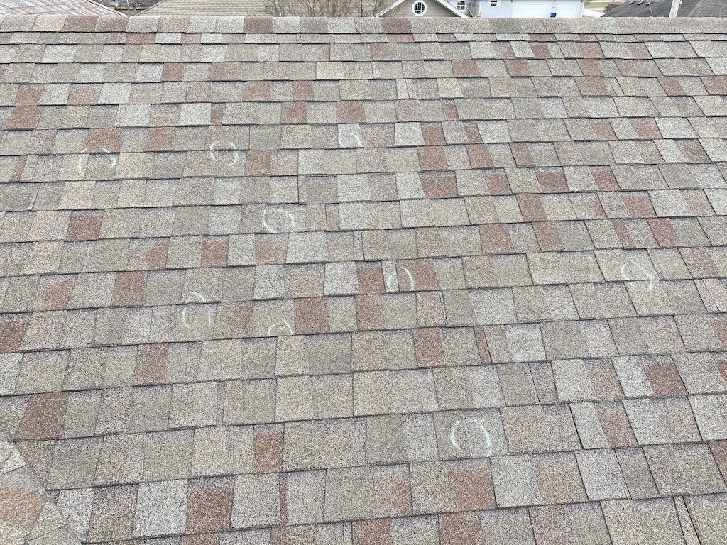 Roof with hail damage marked up with circles showing damage