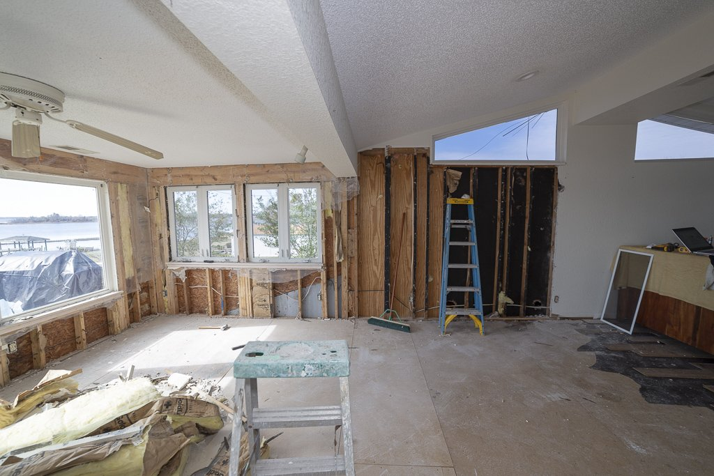 House damaged in hurricane florence with water damage during demolition and exposed stud wall framing and subfloor