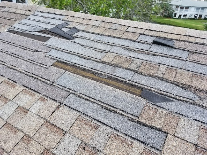 roof leak caused by shingles torn off by wind
