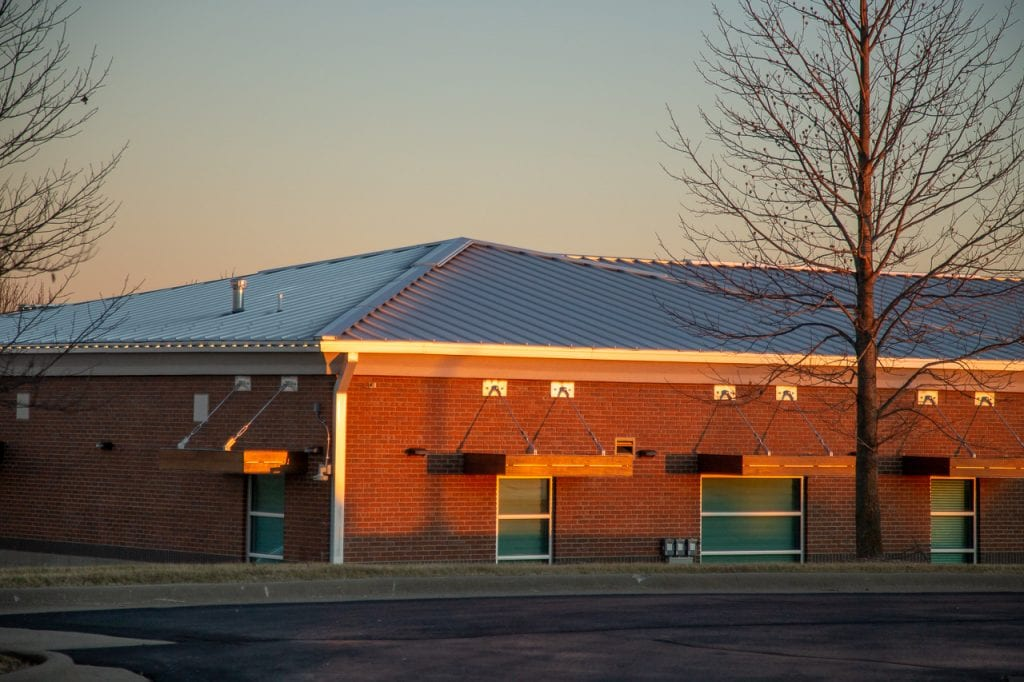 Mitchum Jewelers building in NIxa with a standing seam metal roof in sunset