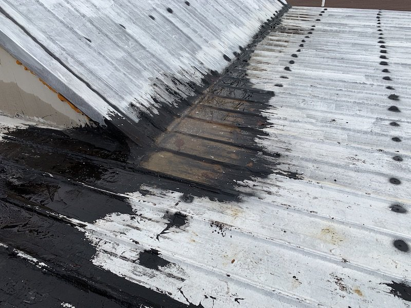 Standing water on metal roof with shallow slope coated with silicone and tar roof is leaking
