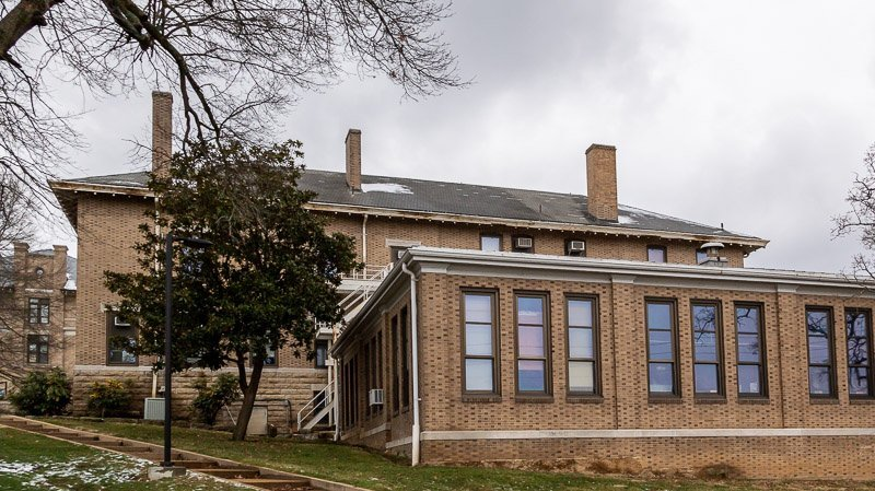 College building has wind damaged shingles and needs a new roof in Rolla MO