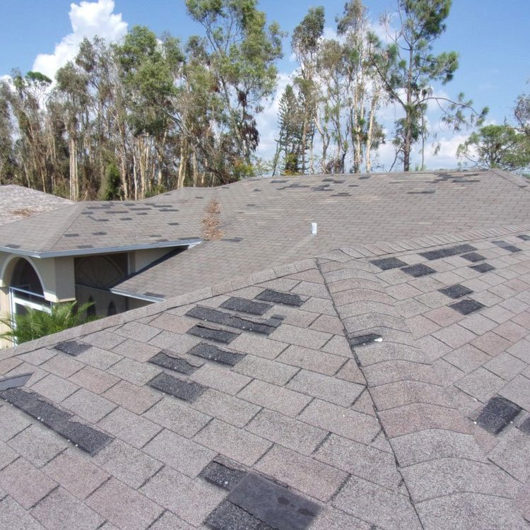 missing shingles on wind damage roof
